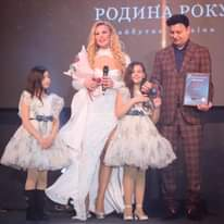 May be an image of 4 people, people standing, indoor and text that says 'родина рок айбутне атни диплом'